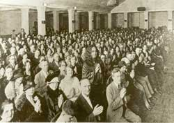 Paramahansa Yogananda, standing, speaks to a full house at the downtown Minneapolis Radisson Hotel in the fall of 1927.